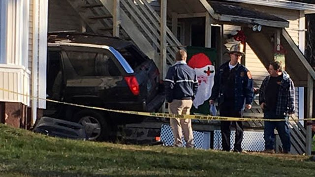 A man was in critical condition after car crashes into the Meriden home. (WFSB)
