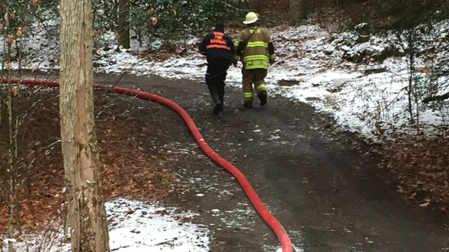 Fire Marshal heads up to scene of a house fire on Estey Road. (WFSB)
