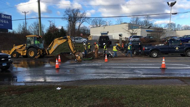 Repair work on a water main that broke in Manchester continued on Friday morning. (WFSB photo)