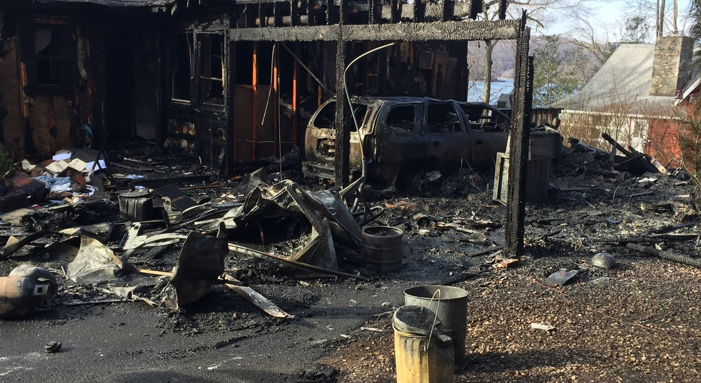 A garage and home were severely damaged after a structurefire in Danbury on Friday morning.(Mark Omasta)