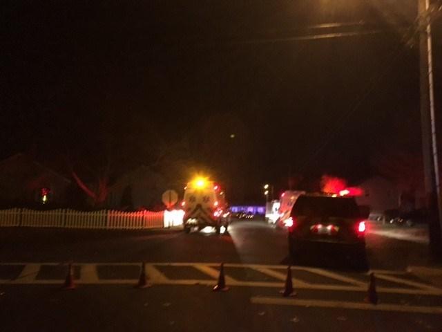 Crews block roads near Walnut Street as firefighters continue to battle a house fire. (WFSB)