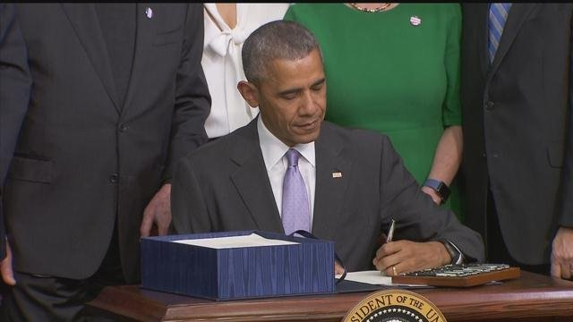 President Obama signed the 21st Century Cures Act into law on Tuesday (WFSB)