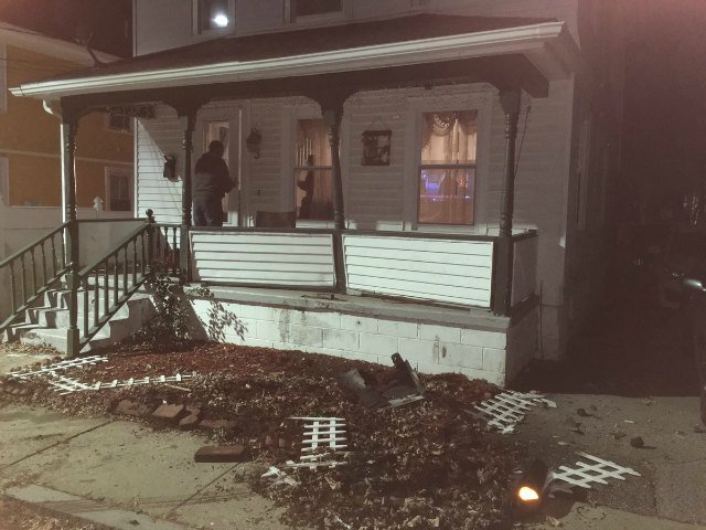 A porch was damaged after a car crashed into it Tuesday.