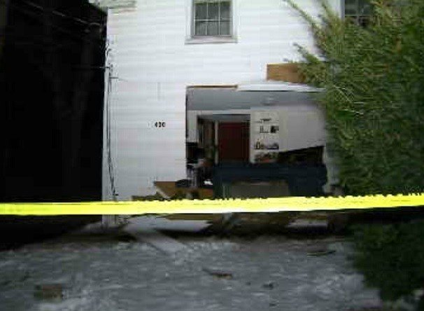 A large home left in the side of a home in New Hartford after a vehicle struckthe building. (WFSB)