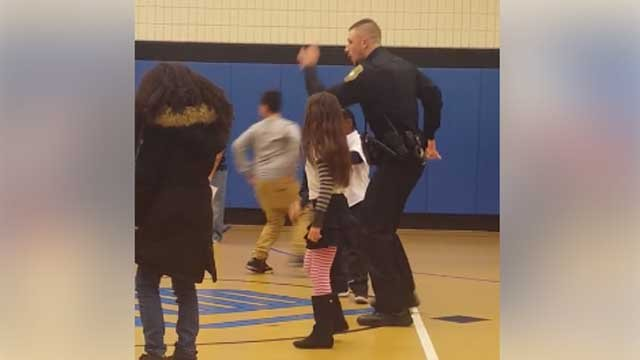 A New Britain officer showed off his dance moves with some children at the Boys & Girls Club last week (Boys & Girls Club of New Britain)