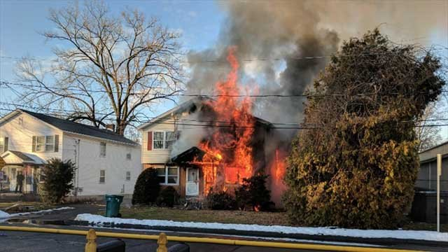 Neighbors rescued a man from a burning home on Christmas Eve (Manchester Fire Department)