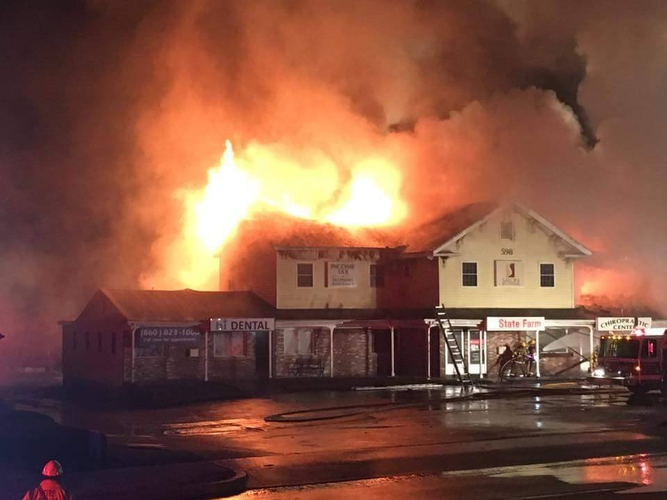 Fire engulfs a mixed use building on West Main Street in Norwich (iWitness submitted photo)