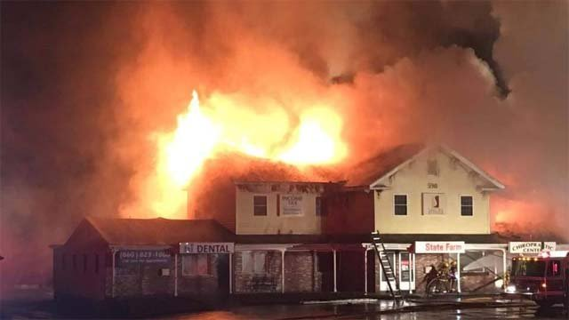 Fire engulfs a mixed use building on West Main Street in Norwich (iWitness photo)