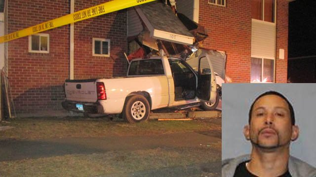 Jose Serrano was charged with DWI after crashing into a West Hartford apartment complex, police said. (West Hartford police photos)