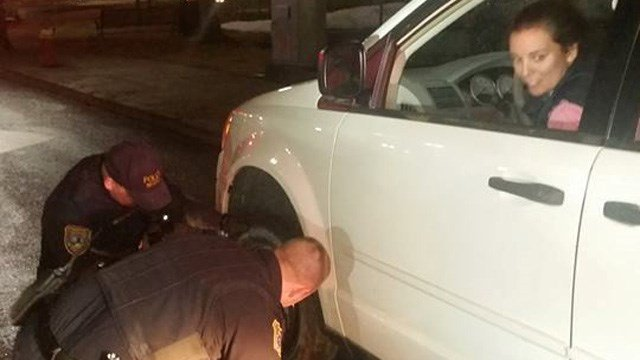 Officers Mike Lounsbury and Mark Nowak stopped to help a stranded driver on New Year's Eve. (Meriden police photo)