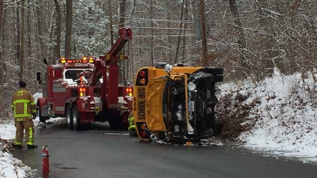 A bus with three people aboard rolled over in Avon on Friday morning. No one was hurt. (WFSB photo)