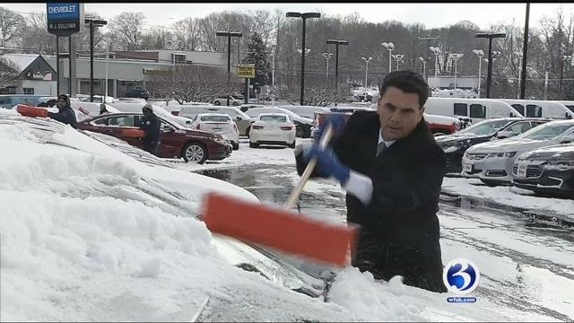 A small army of snow fighters cleared the 700 cars at M.J. Sullivan's Auto Dealerships. (WFSB)