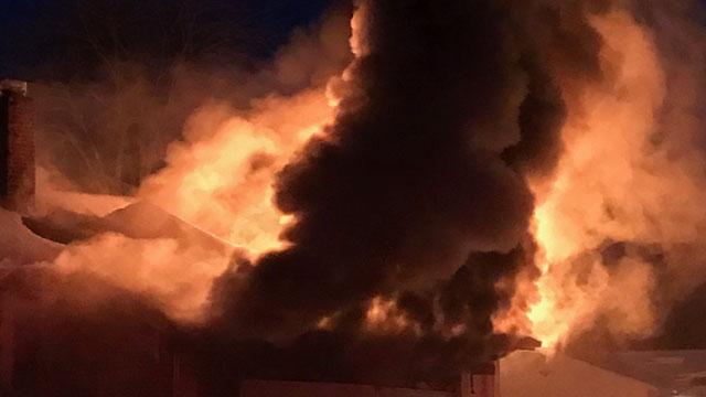 People were displaced after a garage fire in Hamden on Monday evening. (Hamden Fire Department)