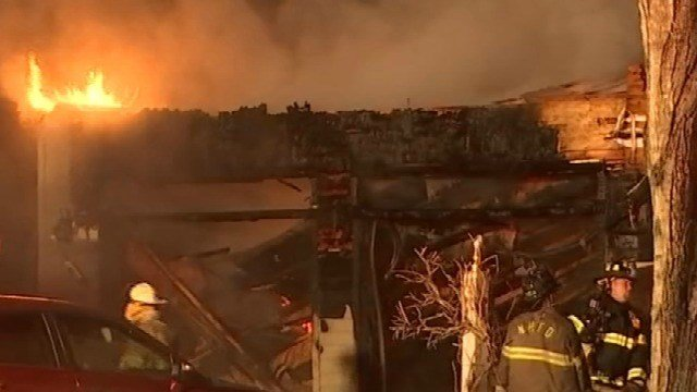 Crews called back to battle hot spots at garage fire in New Hartford (WFSB)