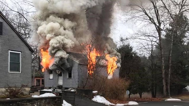 A fire was reported inside a detached two-car garage at 24Roosevelt Dr.around 9:20 a.m. (Doug Zaniewski/iWitness photo)