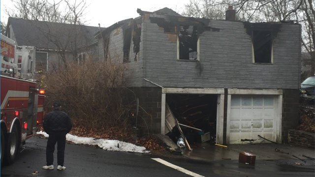Firefighters had to deal with concerns ofammunition inside a garage while battling a fire in Seymour on Thursday morning.(WFSB)