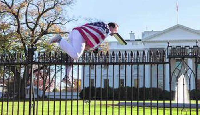 Stamford resident Joseph Caputo was arrested for jumping the White House fence. He's carrying a binder in his mouth. (Source: Vannesa Pena/CNN)