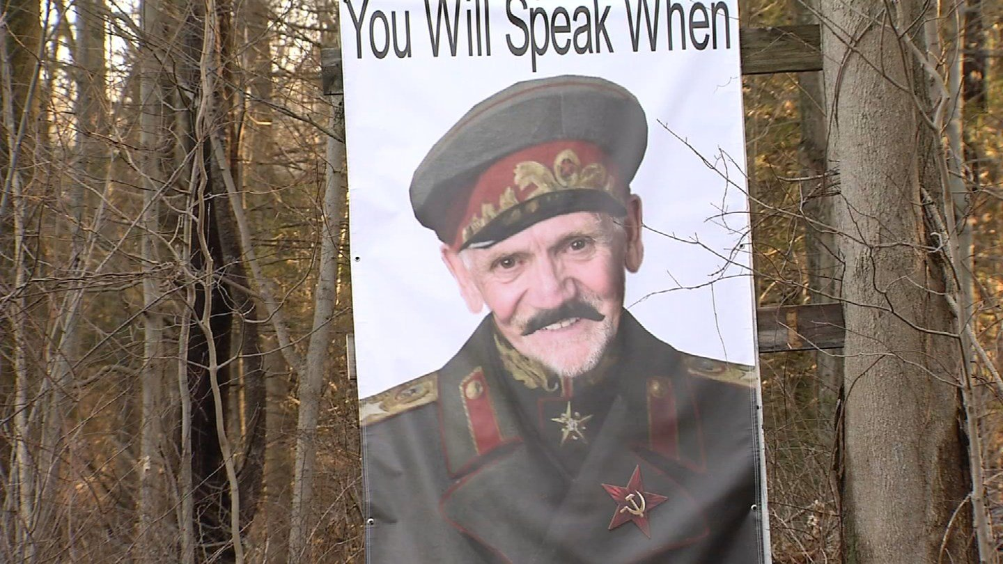 A sign posted by a Woodbury resident depicting the town's First Selectman William Butterly as Joseph Stalin.  (WFSB)