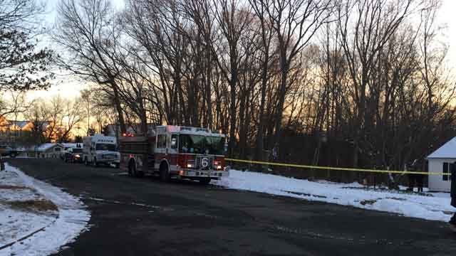 A stolen car was found submerged in a Milford pond on Sunday afternoon (WFSB)