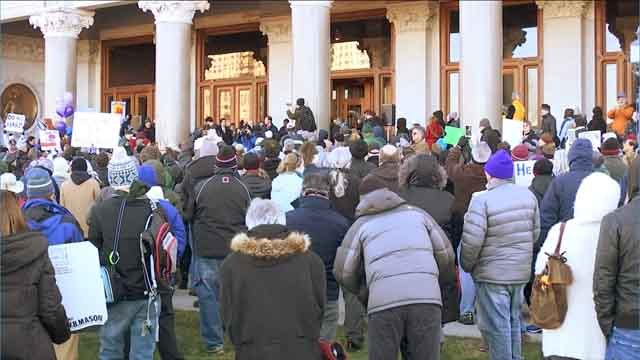 A large crowd gathered for a rally outside the State Capitol on Sunday afternoon. (WFSB)