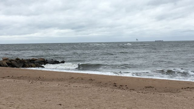 Waves crash along Cosey Beach in East Haven on Monday morning. (WFSB)