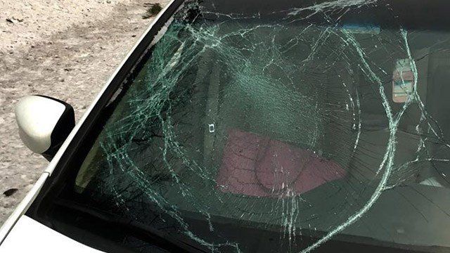 State police said falling ice from the roof of a car damaged this windshield on I-84. (State police photo)