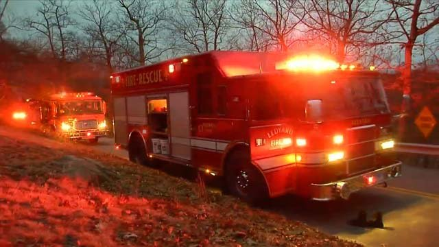 A tree worker was seriously injured after a boom lift tipped over onto a home (WFSB)