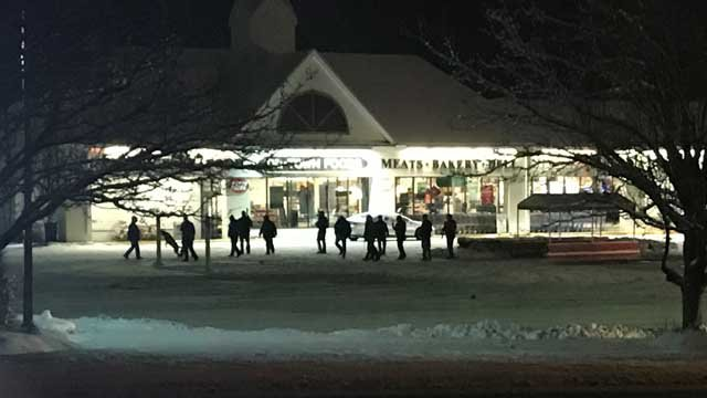 Police and SWAT members surrounded the Tri-Town Foods grocery store on Tuesday evening (WFSB)