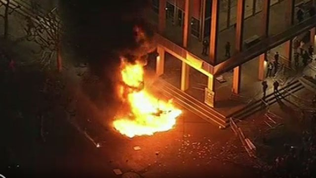 A bonfire was caused by protesters on the campus of University of California at Berkeley on Wednesday. (AP Image)