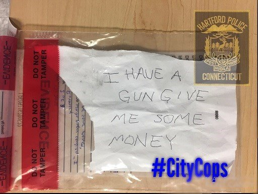 The note handed to a bank teller by robbery suspect Angel Colon (Hartford Police Dept.)