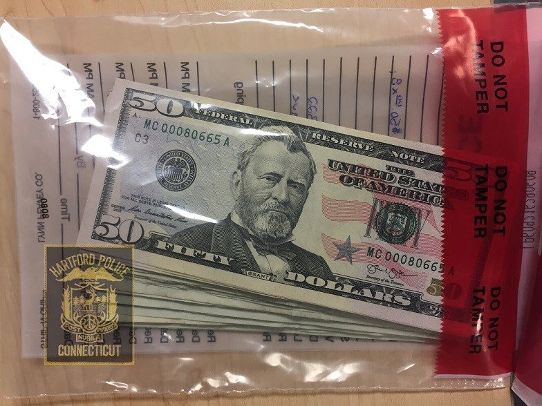 Cash recovered by officer off of Colon.  (Hartford Police Dept.)