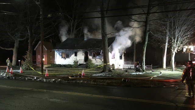 Southington fire officials said a home was fully engulfed in flames Tuesday morning. (WFSB)