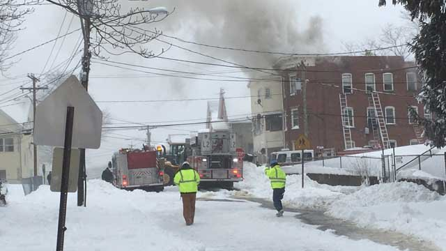 Crews battled a house fire in New Britain on Thursday (WFSB)