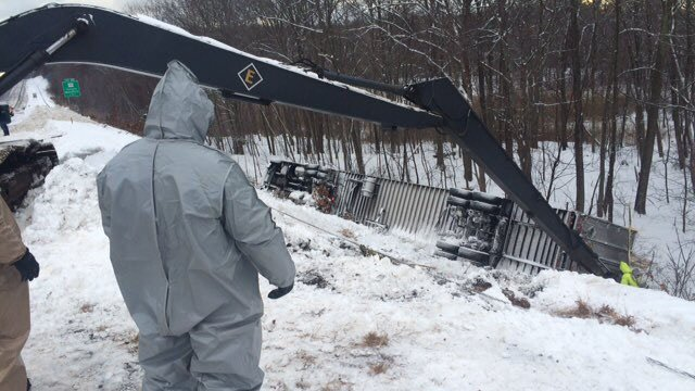Crews worked to remove containers of chemicals from a tractor trailer crash in Tolland. (State police photo)