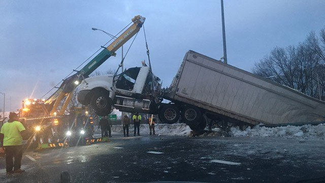 Debris spills down an embankment after a tractor trailer crash on I-91 southbound in New Haven.  (State police)