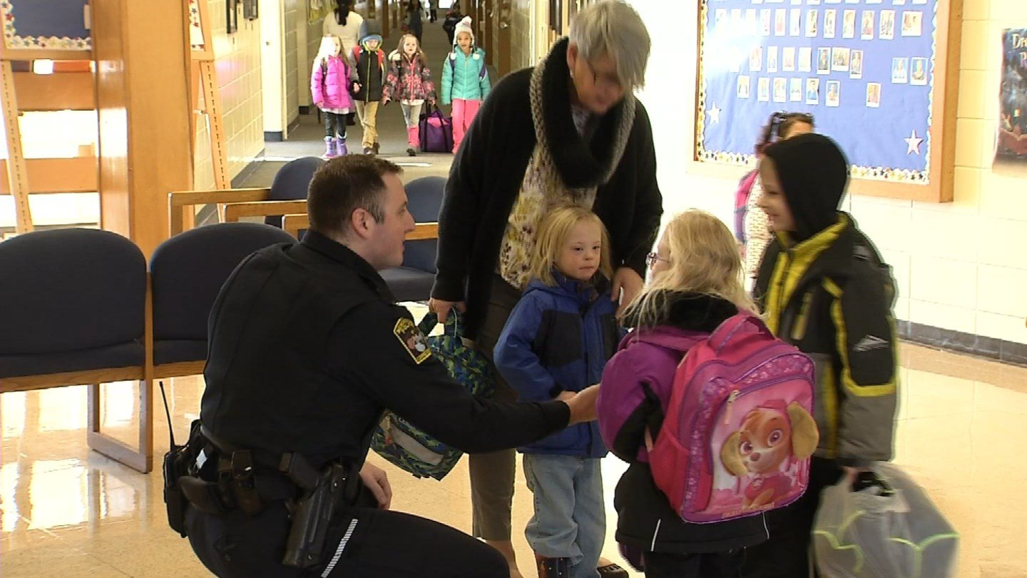 Newington police reach out to young students as part of a new community outreach program. (WFSB photo)