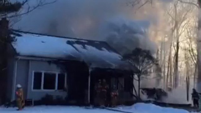 Firefighters battled a house fire on Warbler Way in Gales Ferry on Friday. (@QVEC911 photo)