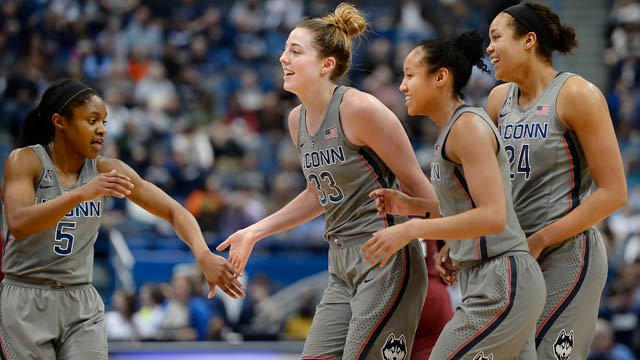 Connecticut's Crystal Dangerfield, Katie Lou Samuelson, Saniya Chong and Napheesa Collier, from left, celebrate as they come off the court for a timeout in the second half of an NCAA college basketball game against Temple. (AP photo)