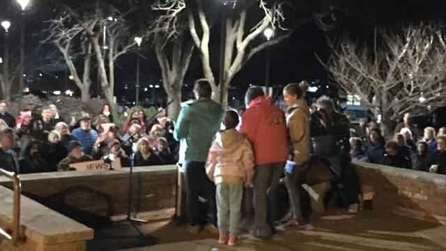 Dozens gathered for a vigil to unite against hate in Windsor on Monday (WFSB)