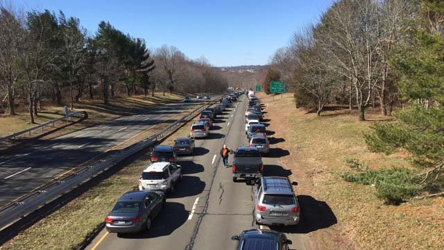There are back ups on Route 15 near the Orange-Derby line after the wind toppled a tree onto van this morning. (WFSB photo)
