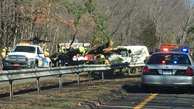 A tree fell on a vehicle on Route 15 in Orange on Thursday, according to state police. (WFSB photo)