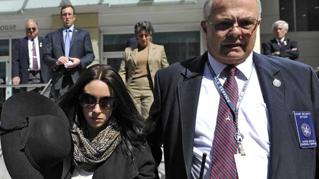 Casey Anthony leaves the federal courthouse in Tampa, with a U.S. Marshal after a bankruptcy hearing on March 4, 2013. (AP Photo/Brian Blanco)