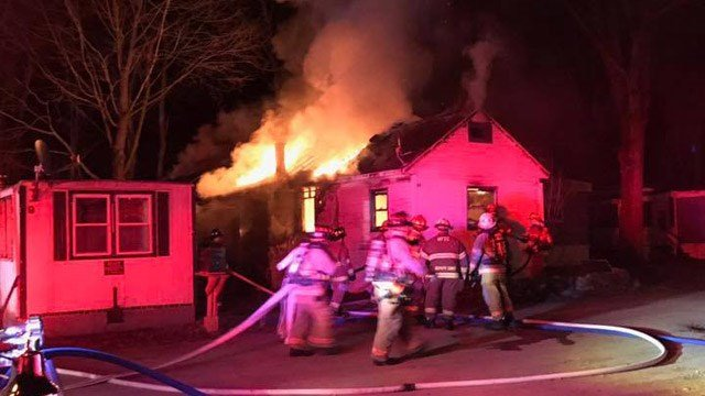 A fire tore through a house trailer in Killingly early Monday morning. (Quinnebaug Valley Emergency Communications photo)