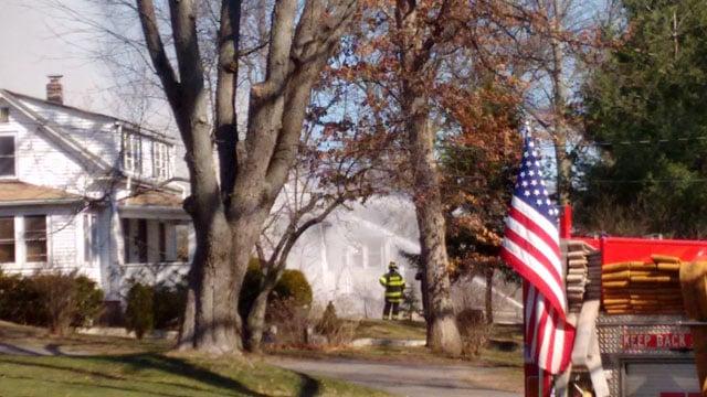 Firefighters battle a fire on Matianuck Avenue in Windsor. (RJ Roy/iWitness photo)