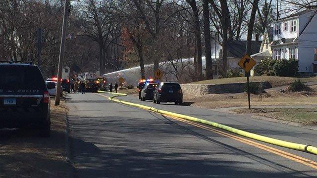 Firefighters battle a fire on Matianuck Avenue in Windsor.  (WFSB)