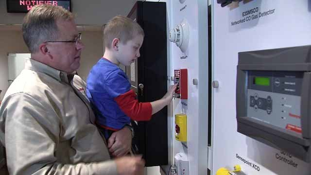 Grandy, who loves fire alarms, got an amazing birthday surprise on Tuesday (WFSB)
