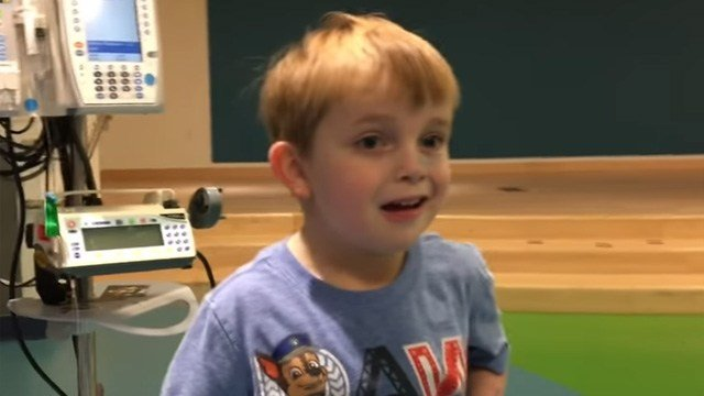 Ari Schultz, 5, reacts to news that he's getting a new heart. (YouTube)