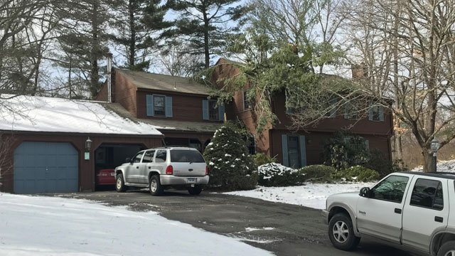 A tree branch fell on a home in Somers. (WFSB)