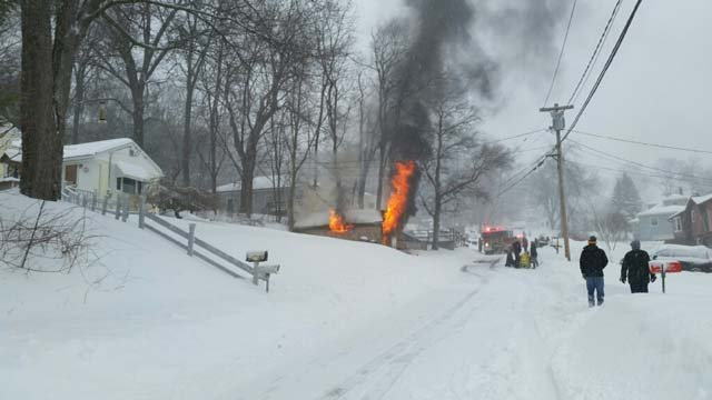 Crews responded to a garage fire in Plymouth on Tuesday (WFSB)