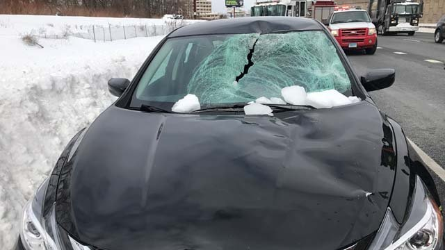 A woman is okay after ice missiles broke through her windshield on Wednesday (WFSB)